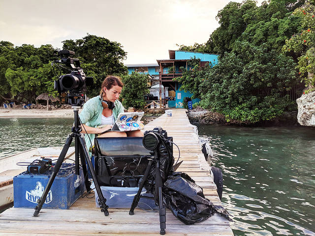Videographer Ellie Mackay preparing on the Carmabi jetty, Encounter Edu